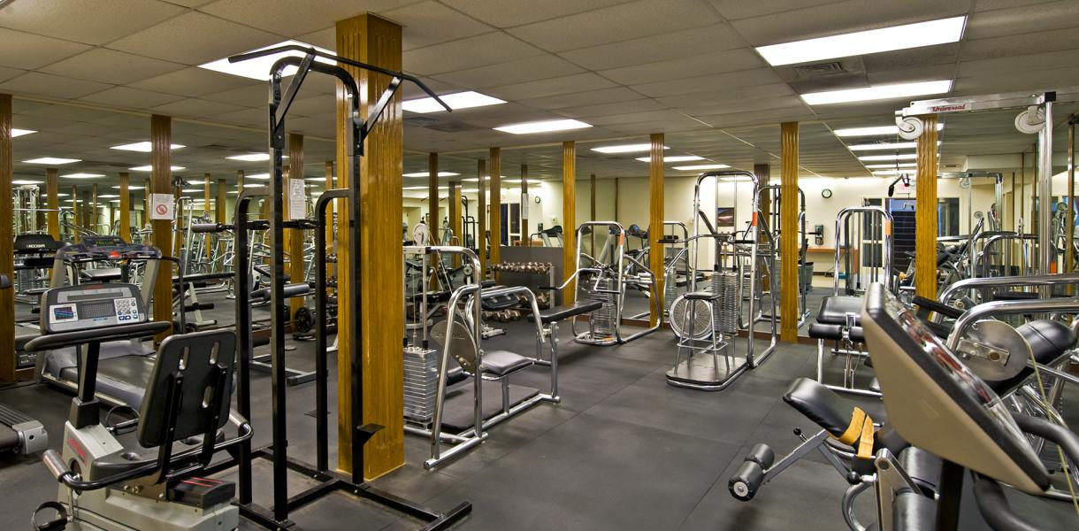 photo of the fitness center at Paladin Club Condominiums featuring various weight machines