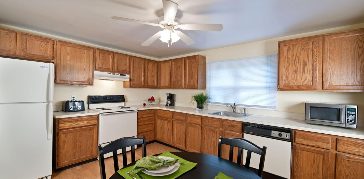 a kitchen within one of the Greenville Place apartments