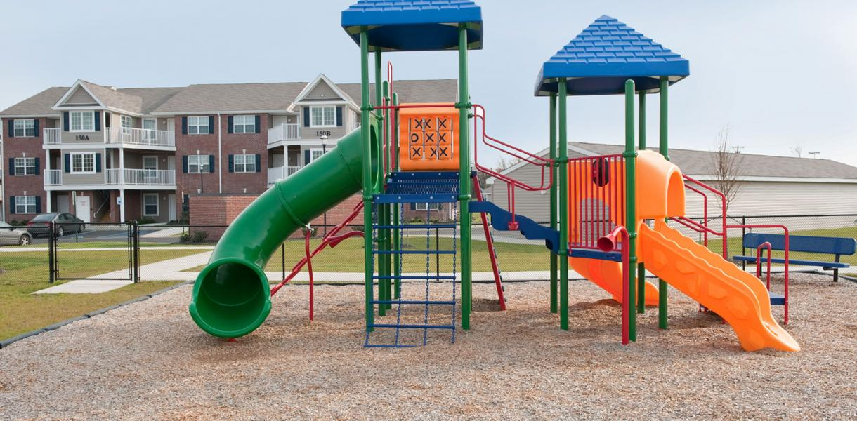 the playground for children at Village at Blue Hen