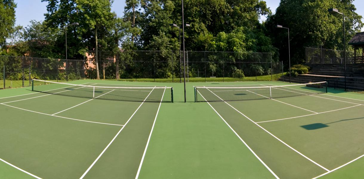 a photo of the tennis courts available for the residents of Paladin Club Condominiums